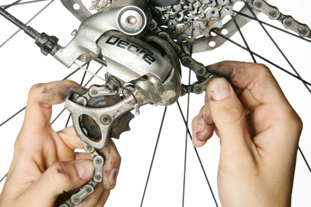 bicycle mechanic fixing a bike in balgowlah